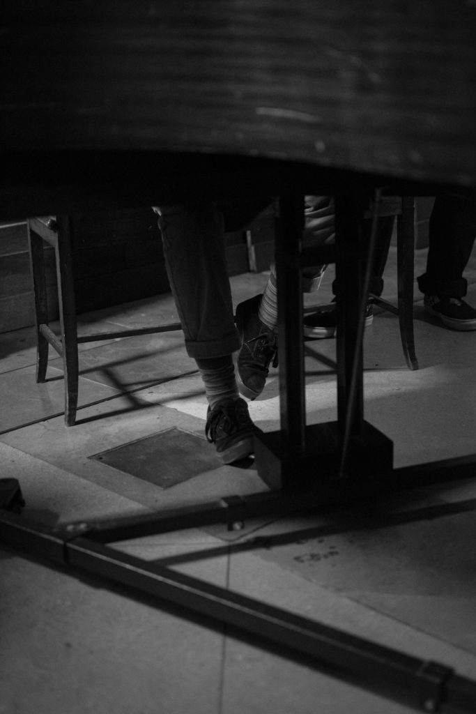 Bridges pianist's feet on the piano pedals. Wex event, Spitalfields church.