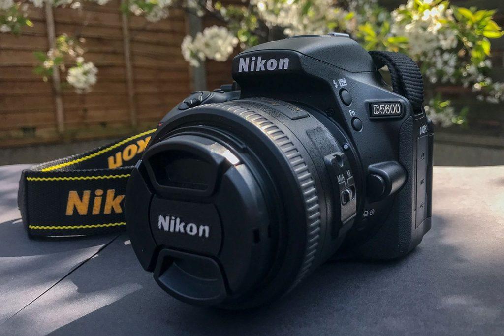 Nikon D5600 DSLR Camera with Nikon Camera Strap