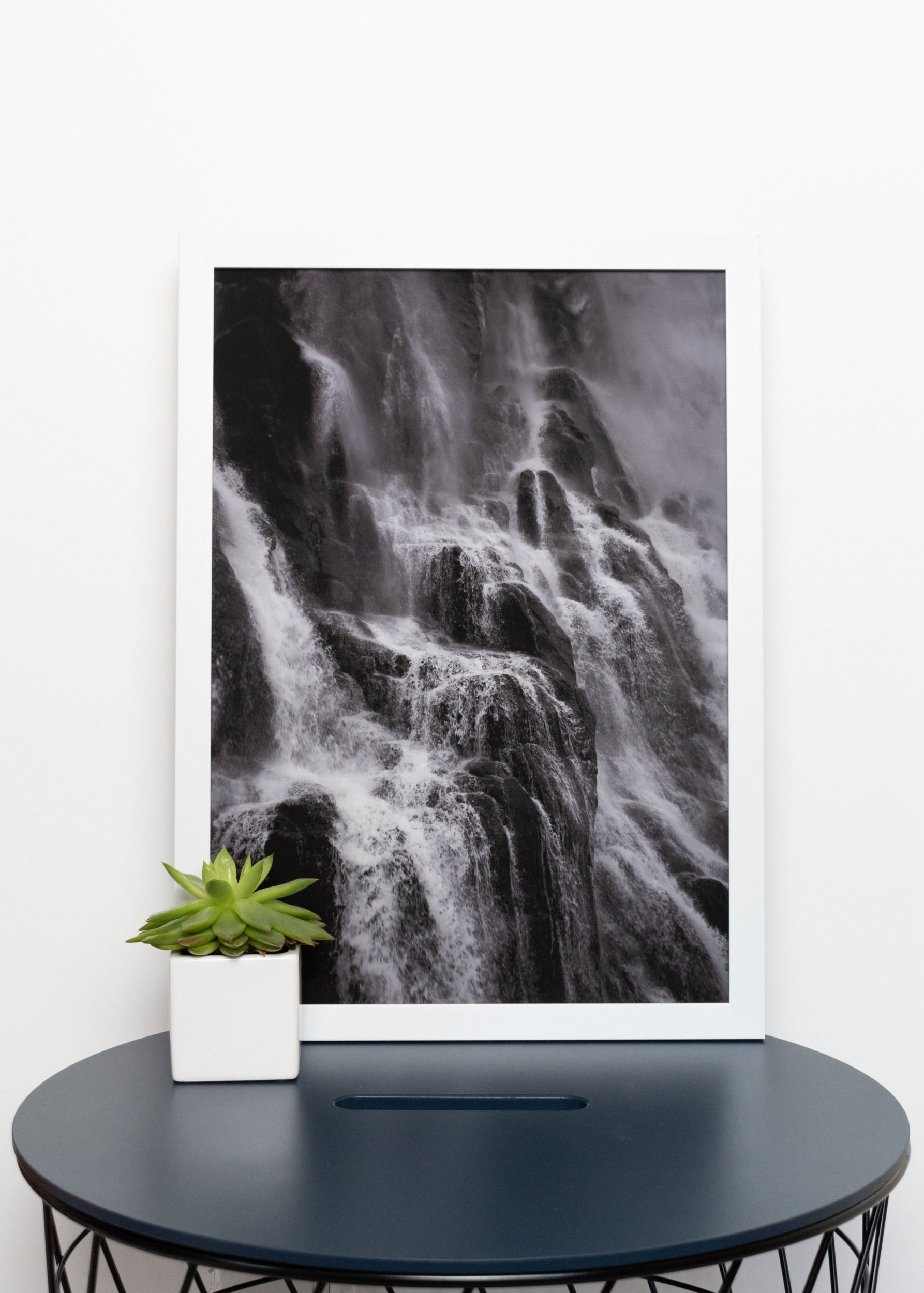 Framed A3 Victoria Broad Photography print of waterfall in Norway, in white frame.