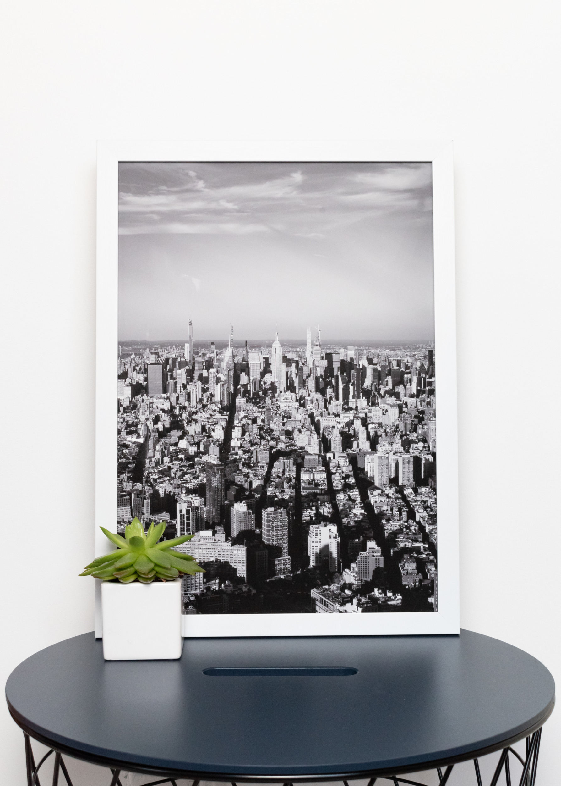 Framed A3 Victoria Broad Photography print of New York skyline, in white frame.
