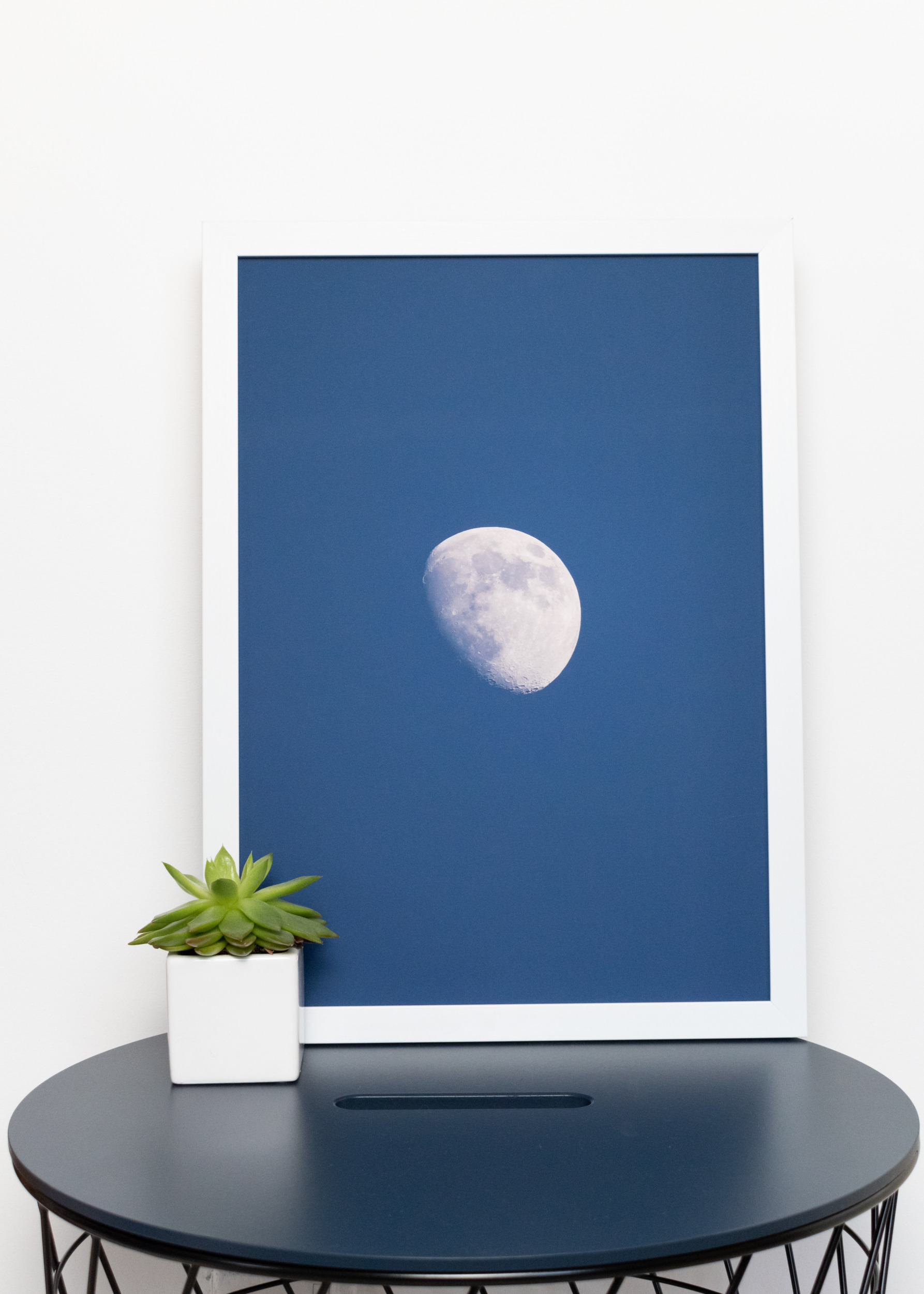 Framed A3 Victoria Broad Photography print of waxing gibbous moon, in white frame.